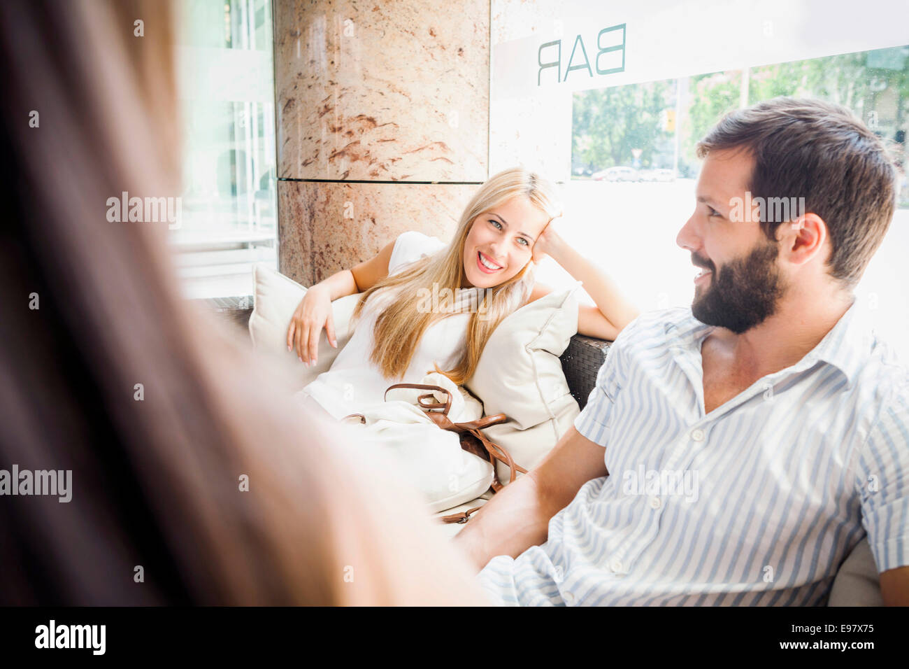 Young couple taking a break in a cafe - Stock Image