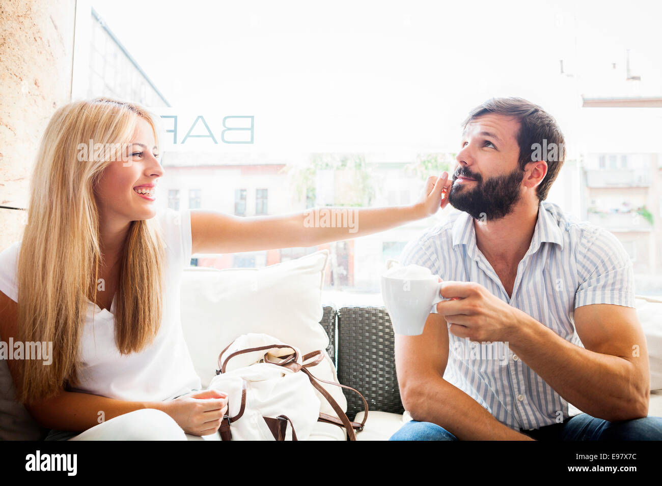 Young couple in cafe fooling around - Stock Image