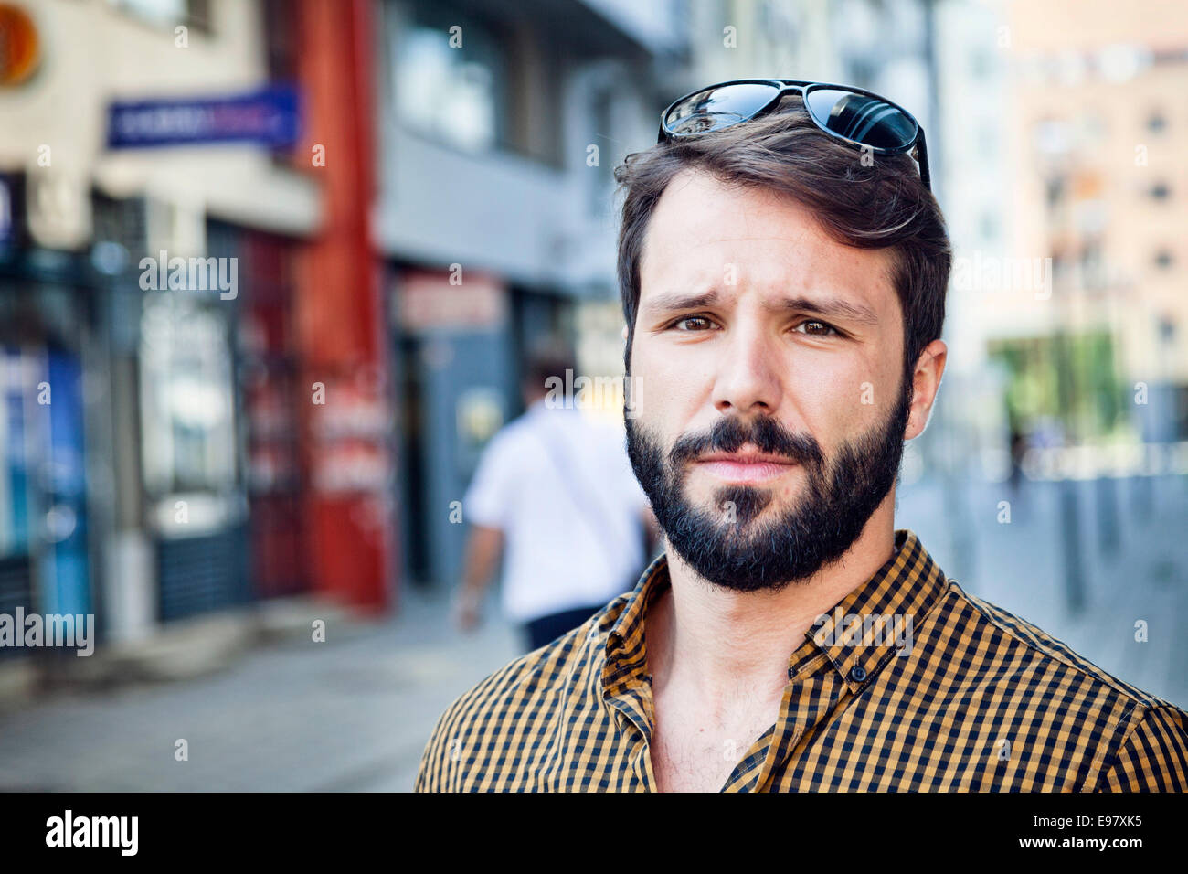 Portrait of young man with beard and sunglasses - Stock Image