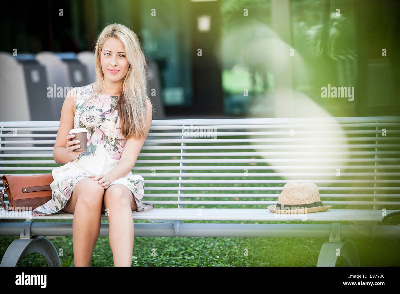 Young woman takes a break having a cup of coffee - Stock Image