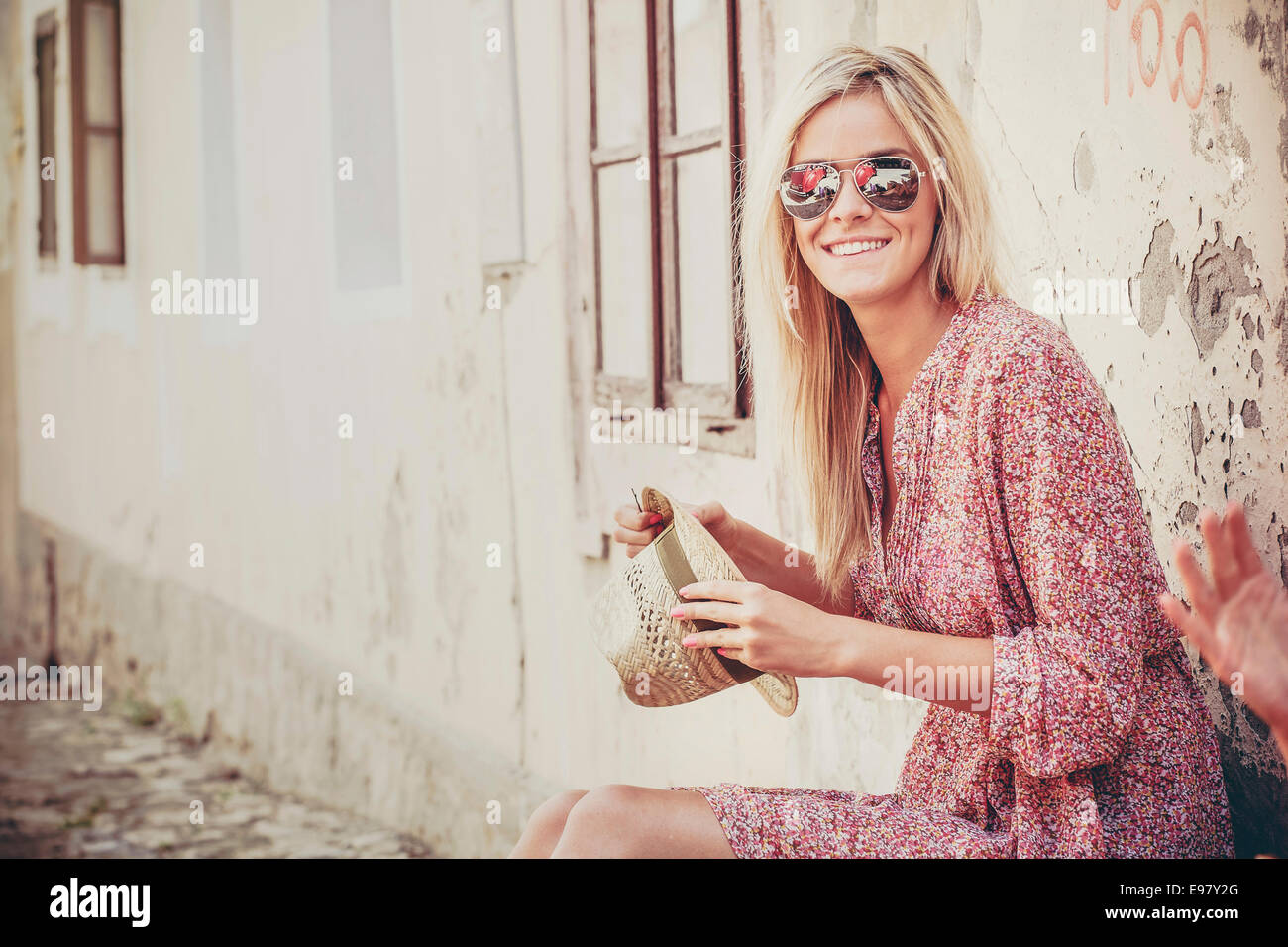 Young woman with blond hair waiting for departure - Stock Image