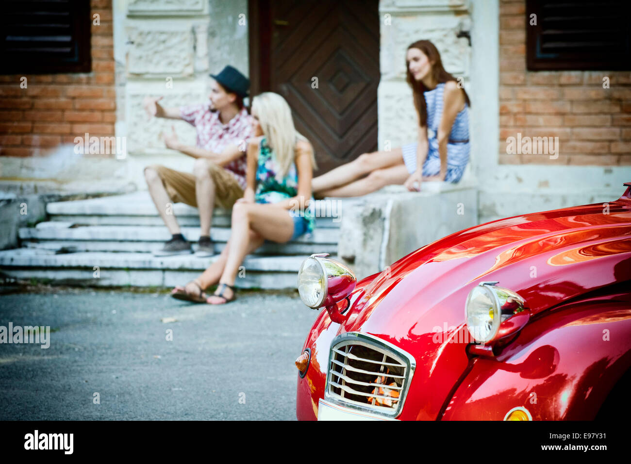 Young people on their road trip taking a break - Stock Image