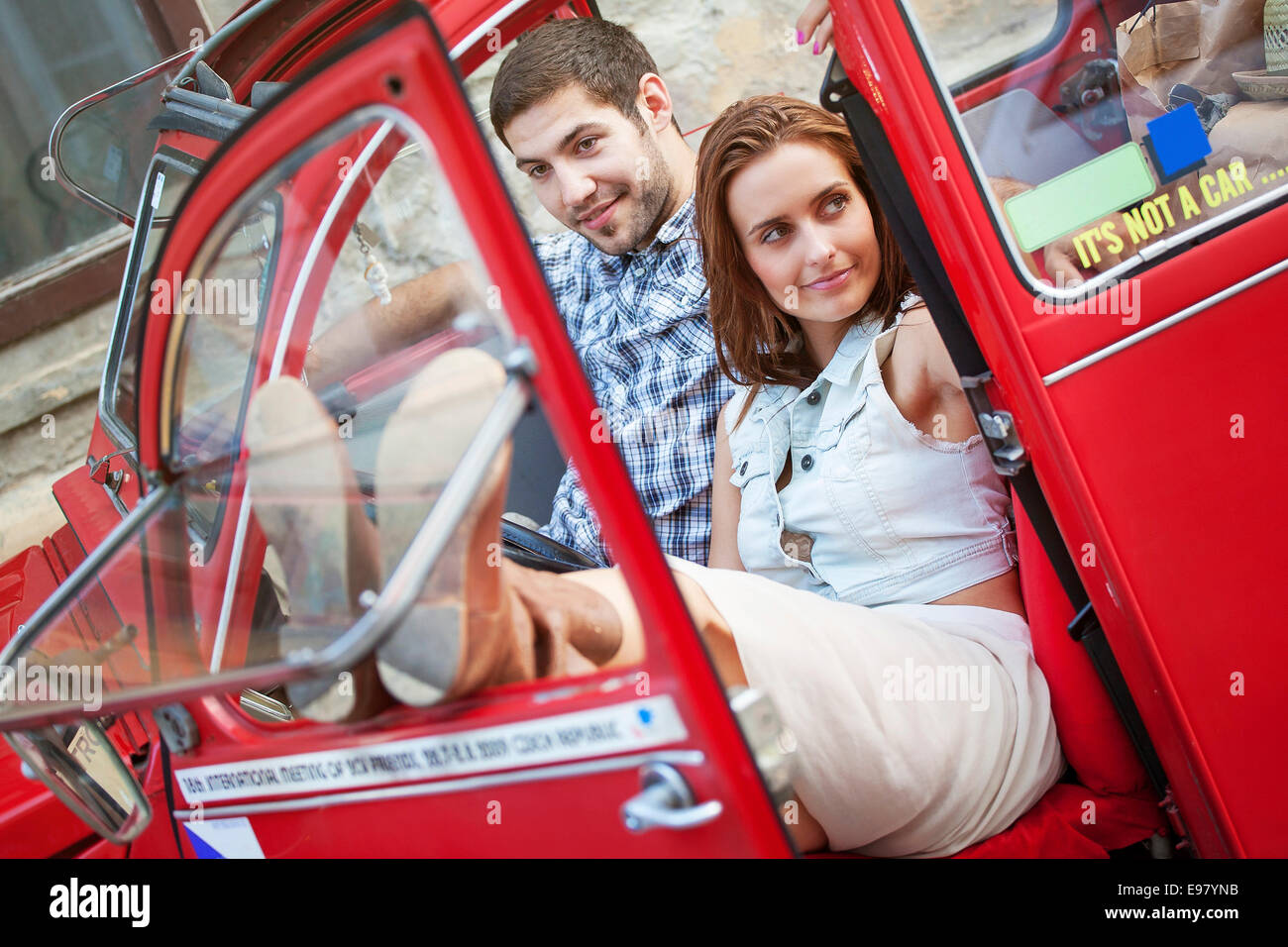 Young couple in vintage car taking a break - Stock Image