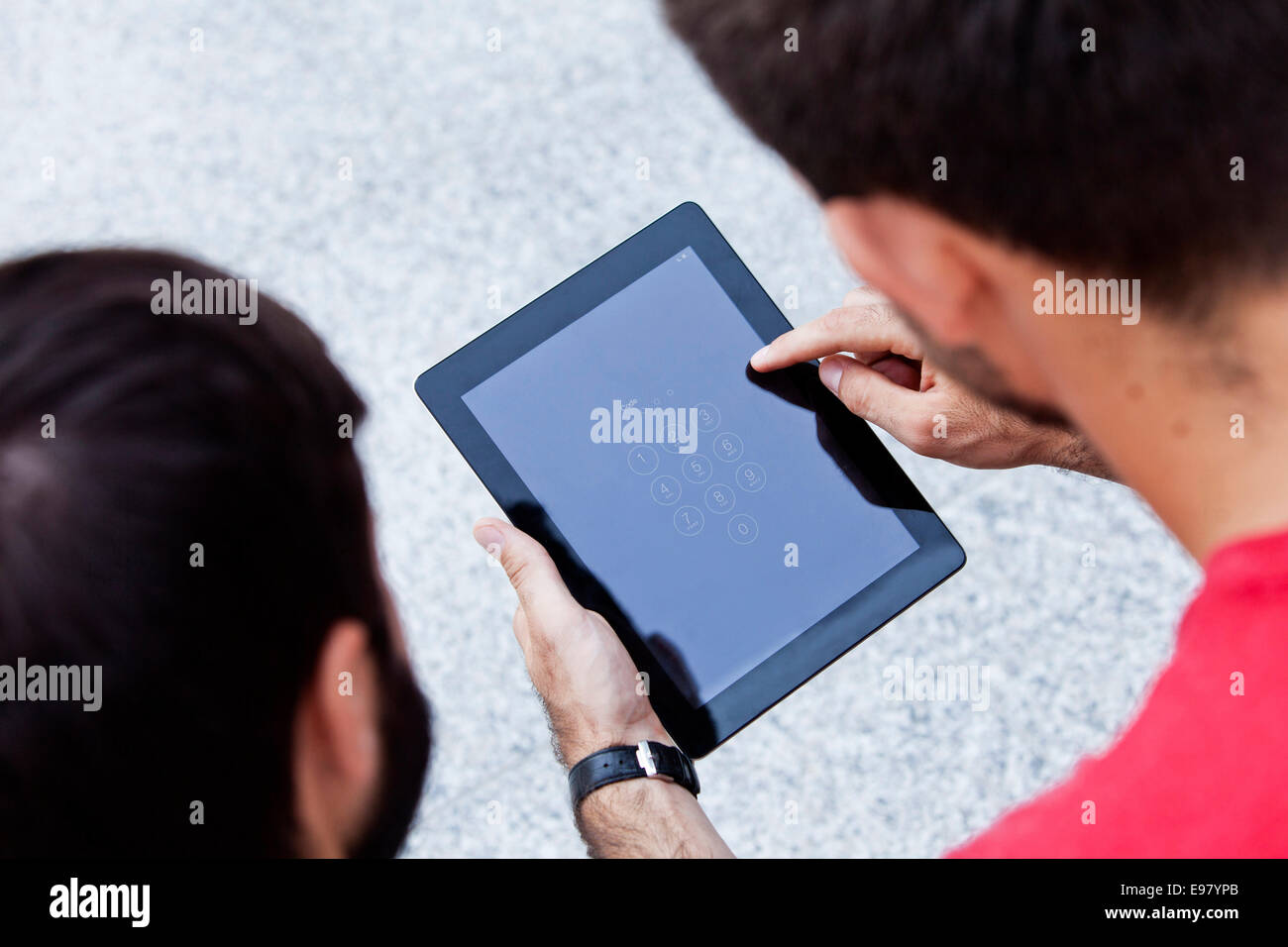 Using digital tablet with touchscreen - Stock Image