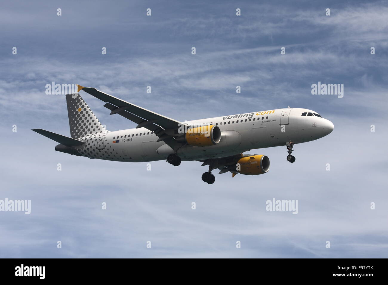 A Vueling Airbus A320, coming in to land. - Stock Image