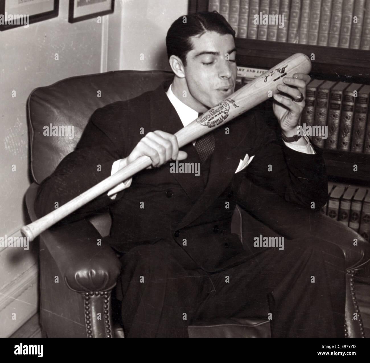 Joe DiMaggio about to kiss his signature baseball bat - Stock Image