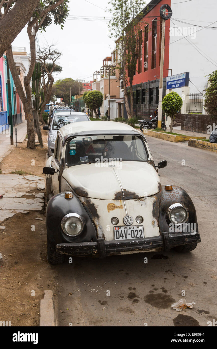 Dilapidated black and white Volkswagen Beetle car in a street in Barranco, Lima, Peru Stock Photo