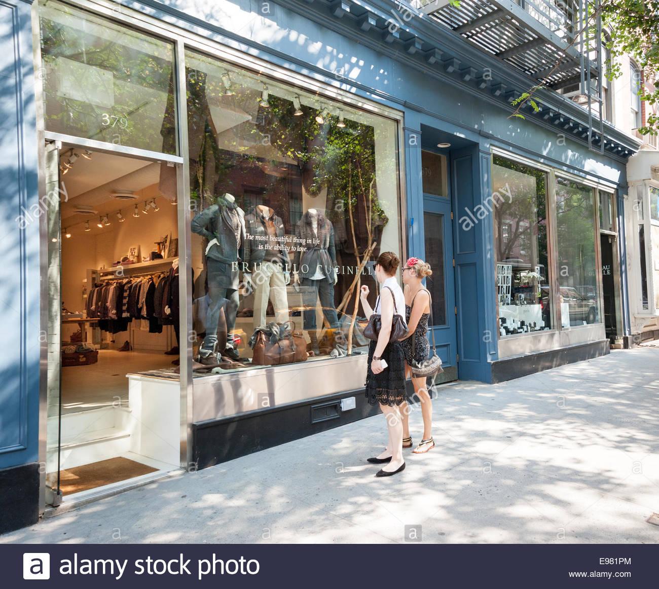 Young women window shopping in Bleecker Street, Greenwich Village, New York City, USA - Stock Image