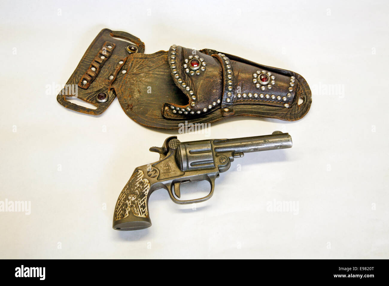 An antique cap pistol and leather holster circa 1900 - Stock Image