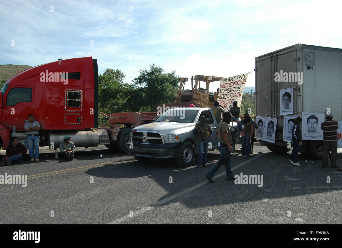 Guerrero, Mexico. 21st Oct, 2014. Members of the Community Police block the street near the missing site of 43 students - Stock Image