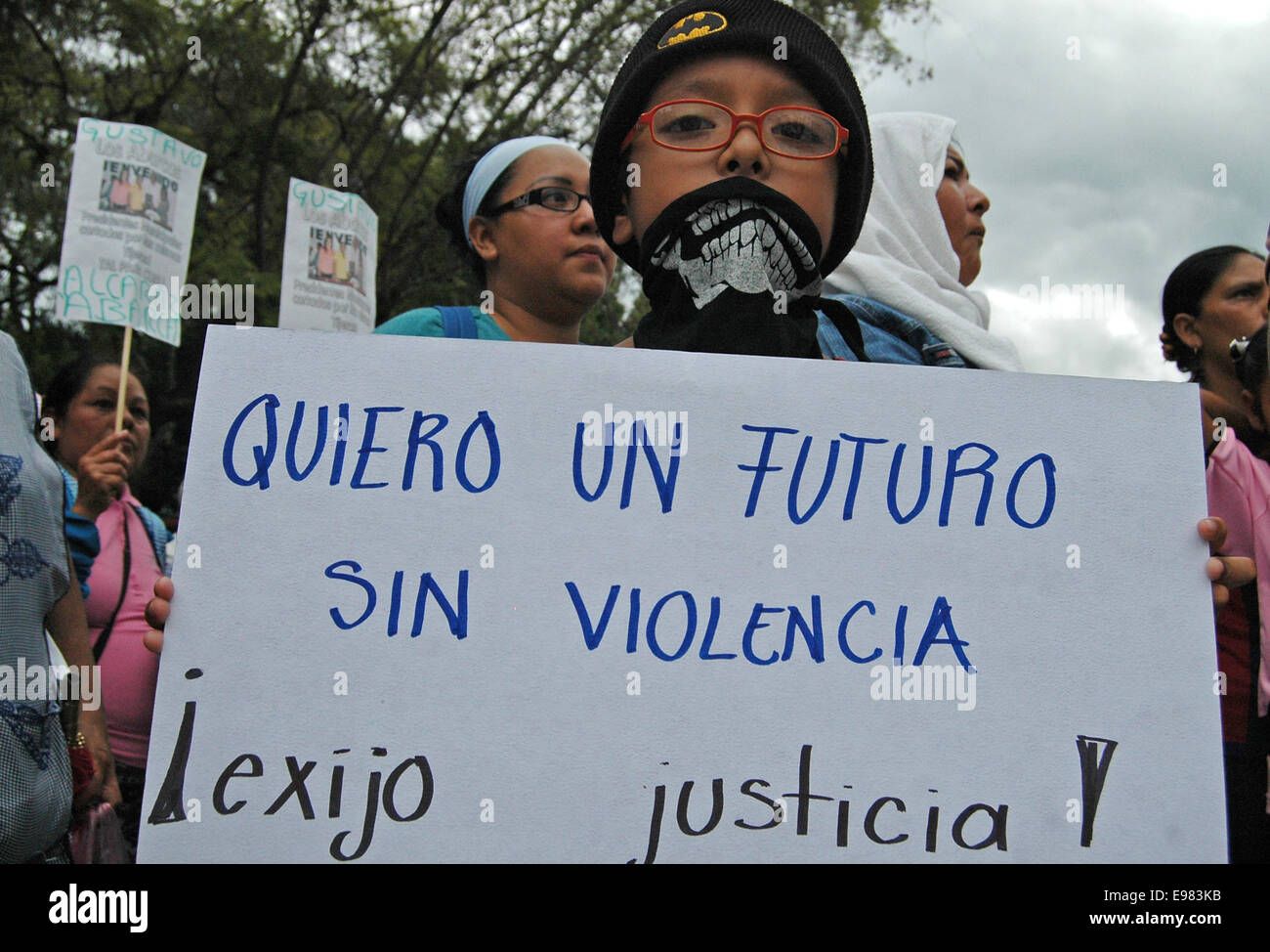 Guerrero, Mexico. 21st Oct, 2014. A student holds a placard during a demonstration demanding justice for 43 missing - Stock Image