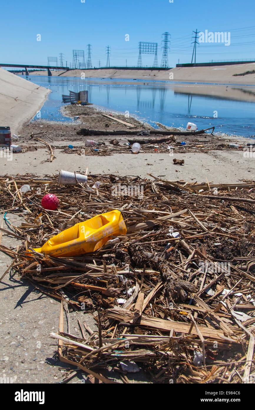 Trash alongs banks of Los Angeles River, Long Beach, California, USA - Stock Image