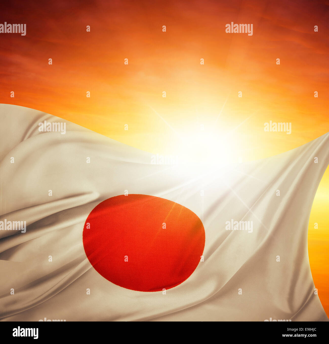 Japanese flag in front of bright sky Stock Photo