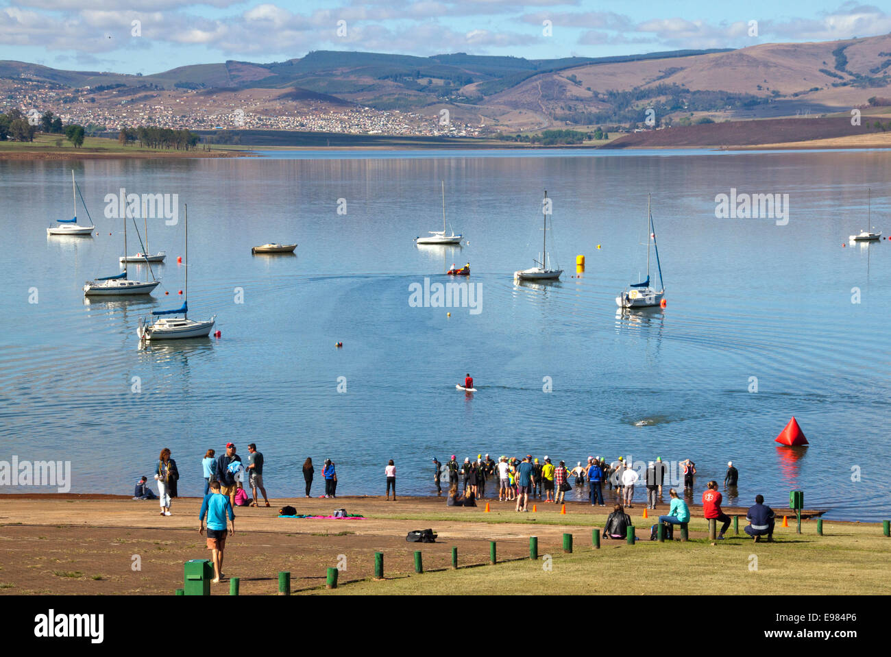 participants and spectators gather for the start of the On LIne Tri Series Race 1 triathlon at Midmar Dam in the Stock Photo