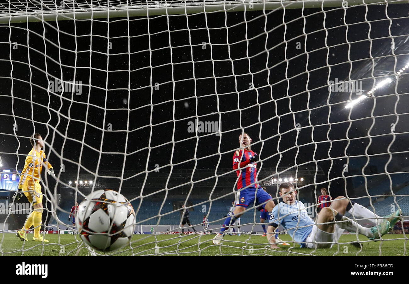 Moscow Region, Russia. 21st Oct, 2014. Manchester City's James Milner (R) scores past CSKA's galkeeper Igor - Stock Image