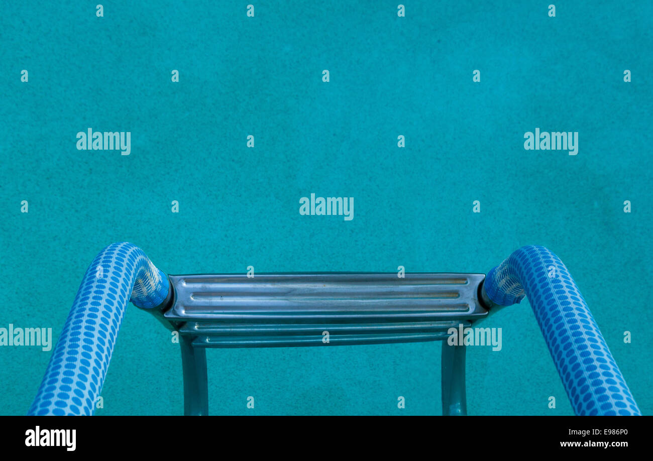 blue ladder pool poolside water handrail - Stock Image