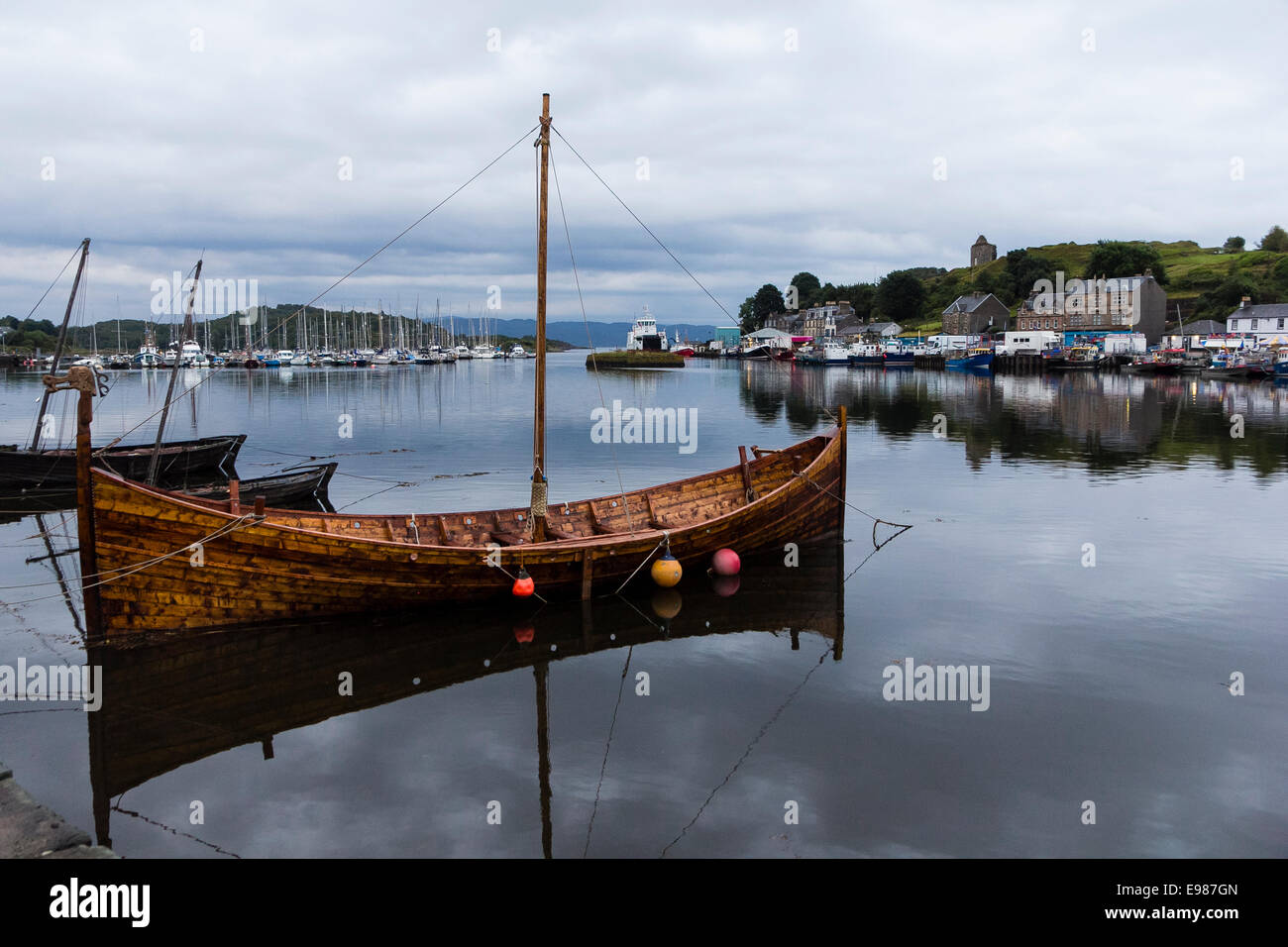A replica of a wooden hulled Viking longship in Tarbert Harbour, Kintyre, Argyll and Bute, Scotland - Stock Image