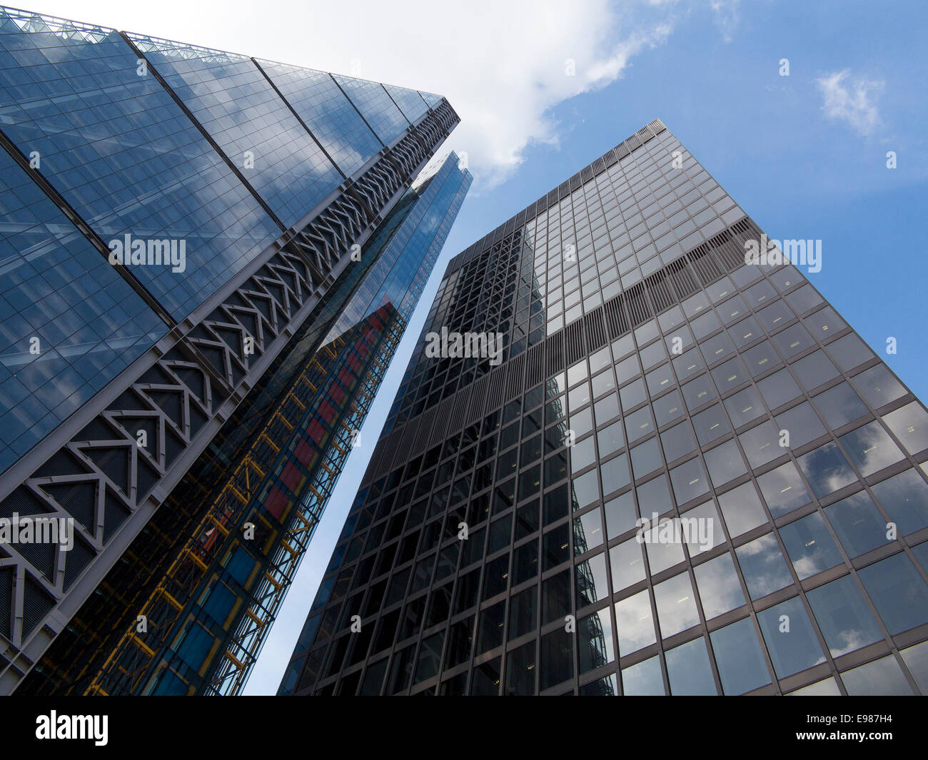 The Leadenhall Building in the City of London, nicknamed the Cheesegrater, stands besides the Aviva Tower - Stock Image
