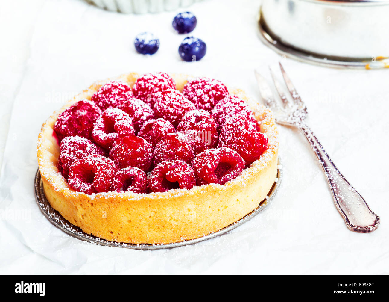 Summery Raspberry Pie and a cake pan on white background - Stock Image