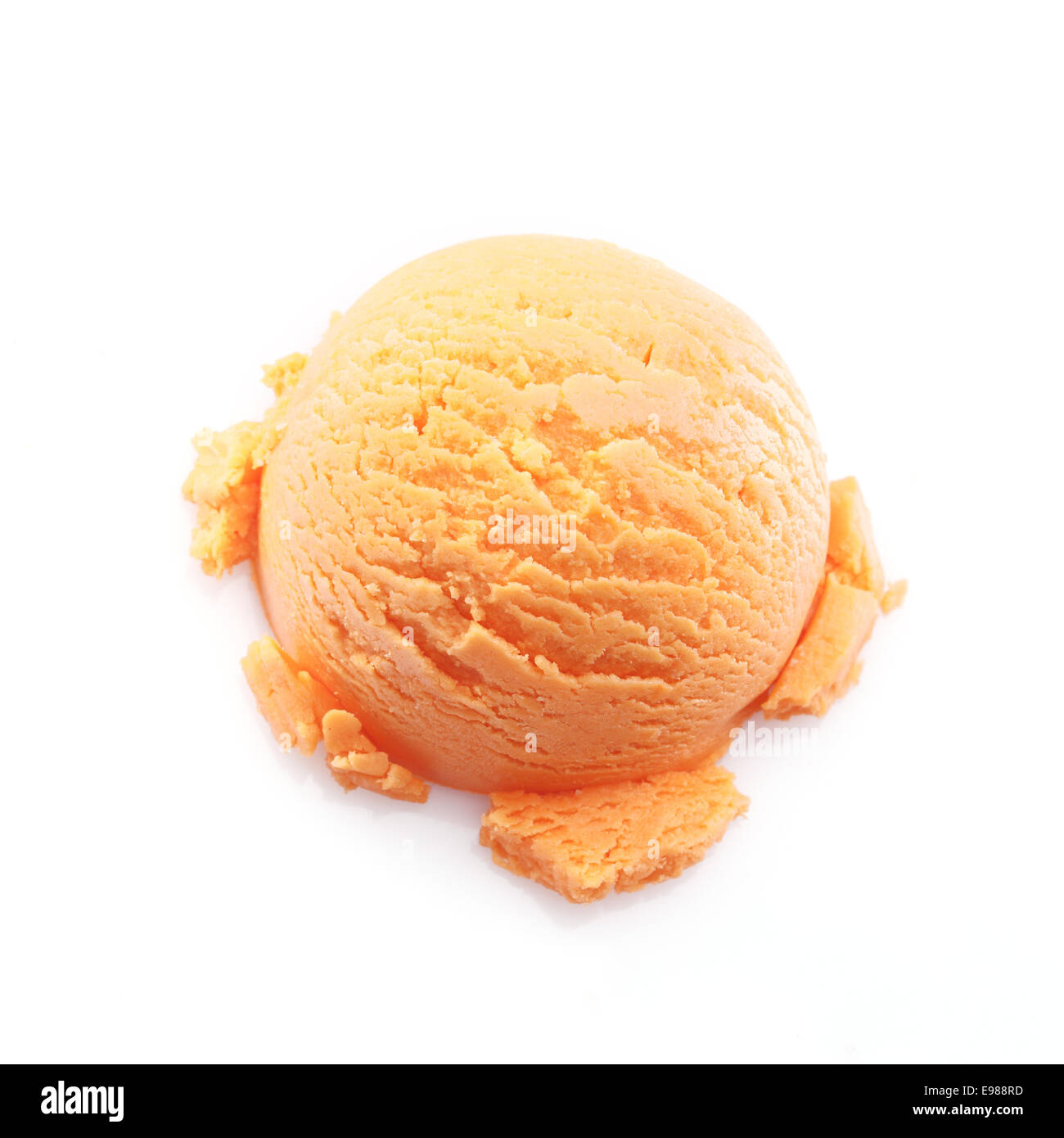 High angle view on a scoop of mango ice cream isolated on white background - Stock Image
