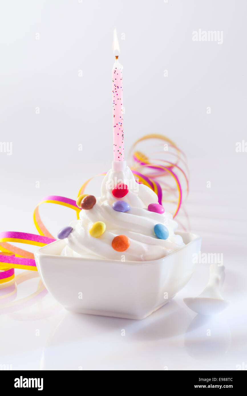 Festive And Birthday Dessert With Candle Frozen Yogurt Served With
