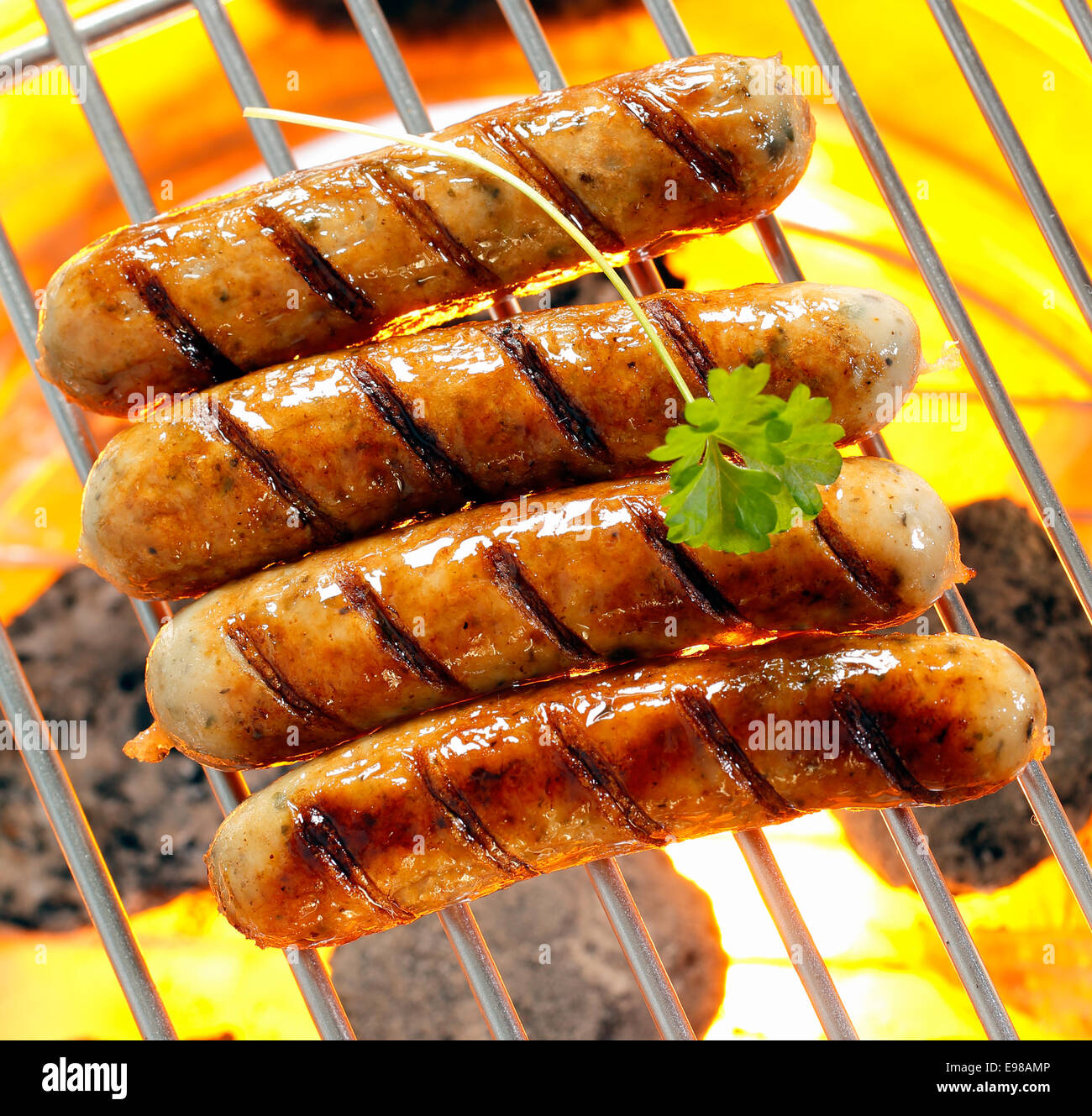 Helalthy smokies on barbecue with Open Flames - Stock Image