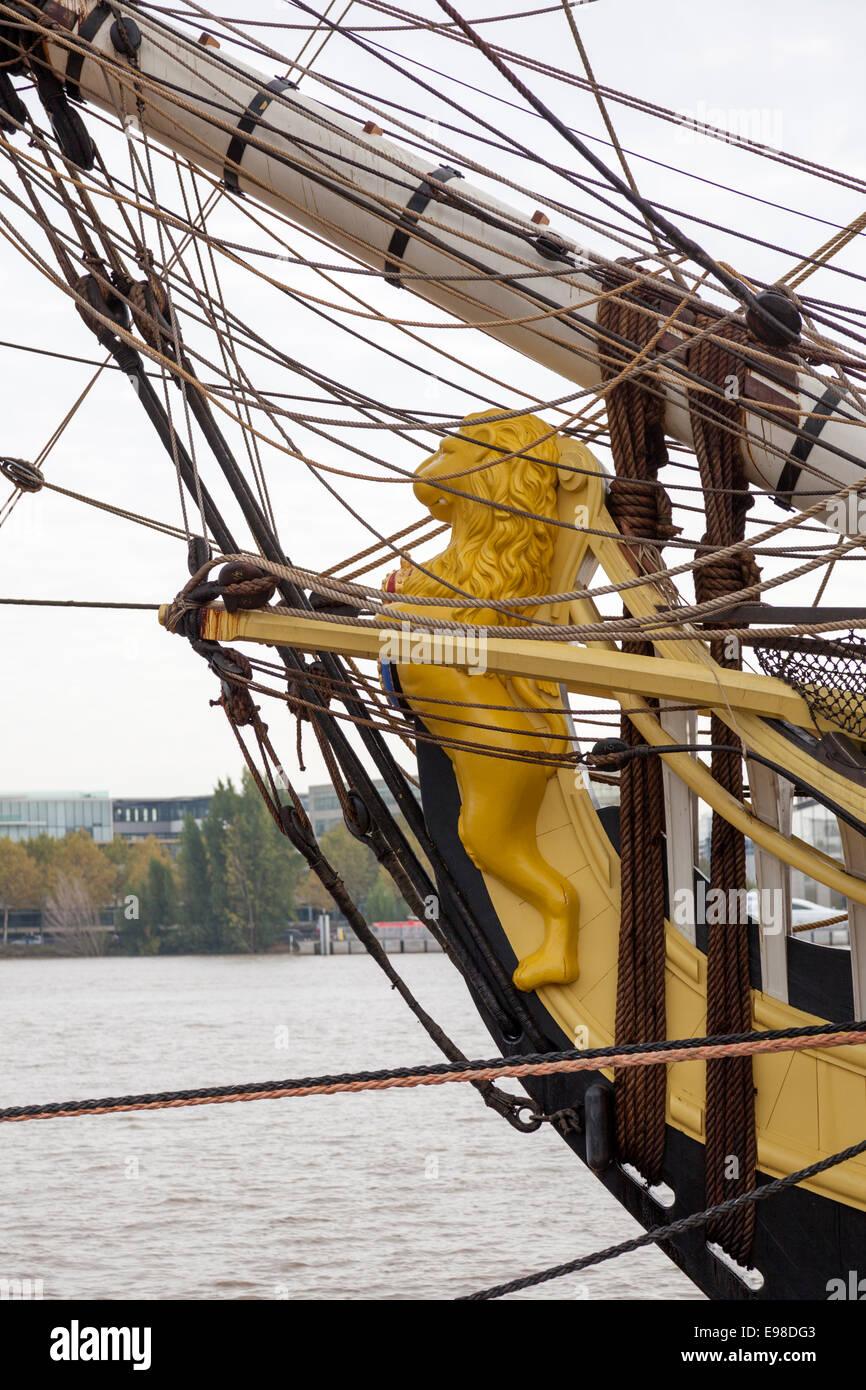 The figurehead of the frigate l'Hermione. That sculpture shows a lion holding a blazon. La figure de proue de - Stock Image