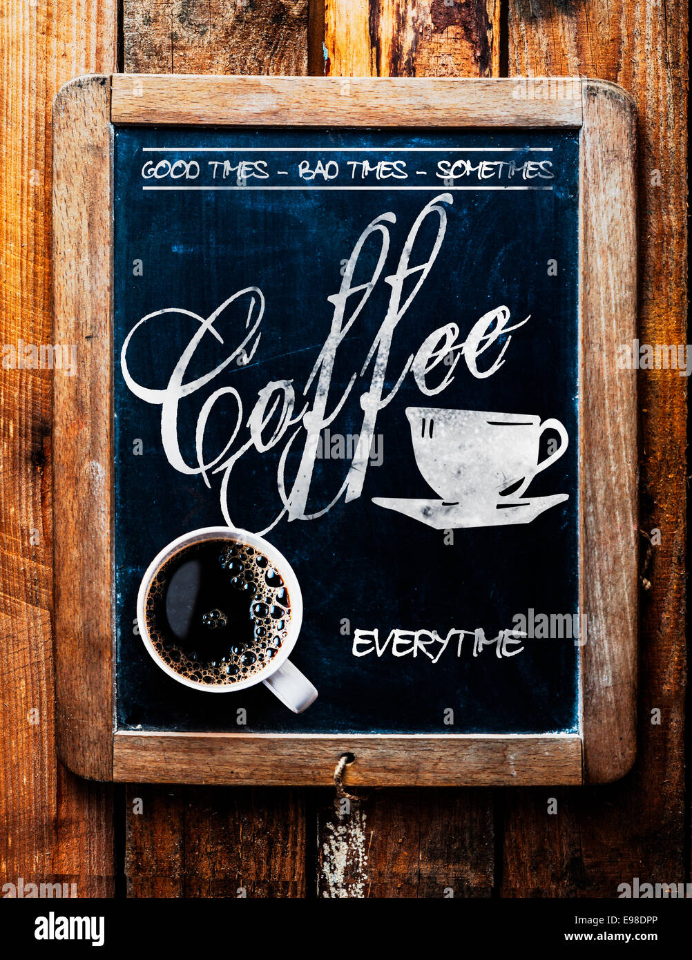 Cup of espresso coffee on a catchy sign saying - Good times, Bad times, Sometimes - Coffee Everytime - on an old - Stock Image
