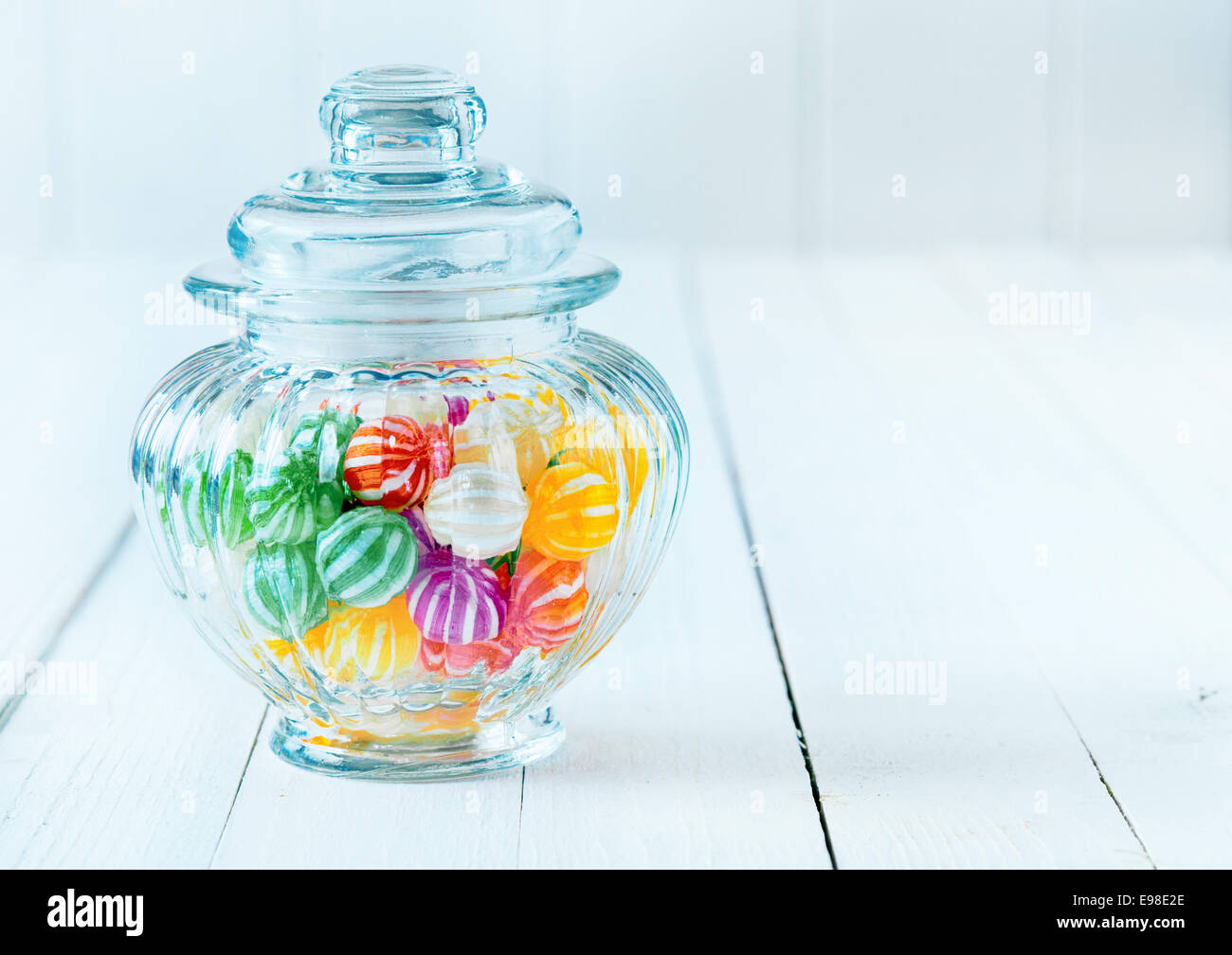 Photograph of a beautiful jar full of assorted colorful candies, perfect for gift purpose. - Stock Image