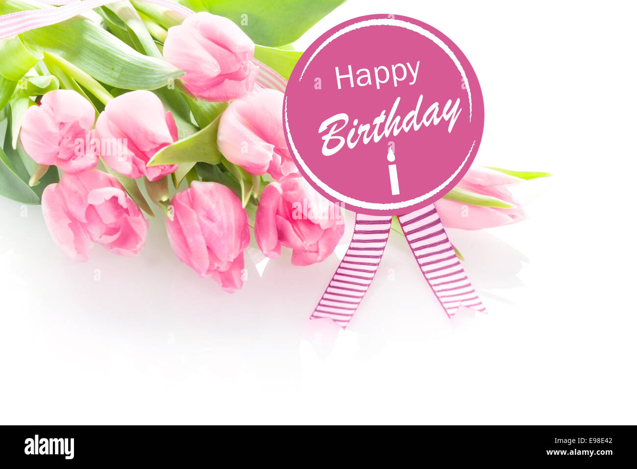 Happy birthday greetings text flowers stock photos happy birthday bunch of beautiful fresh pink tulips with a happy birthday greeting message on a round purple izmirmasajfo