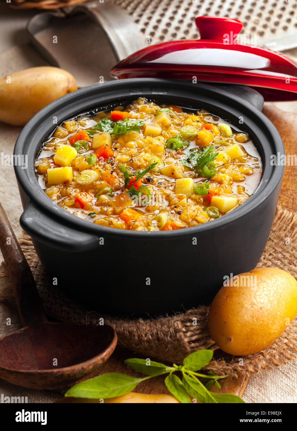 Delicious lentil and vegetable stew in a rustic kitchen in an open crock, high angle view Stock Photo