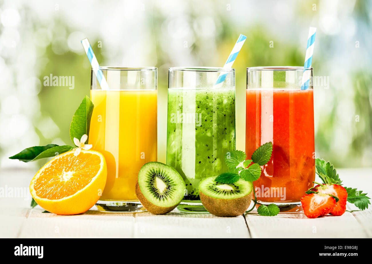 Delicious array of fresh fruit juices served in tall glasses made from liquidised orange, kiwifruit with peppermint, - Stock Image