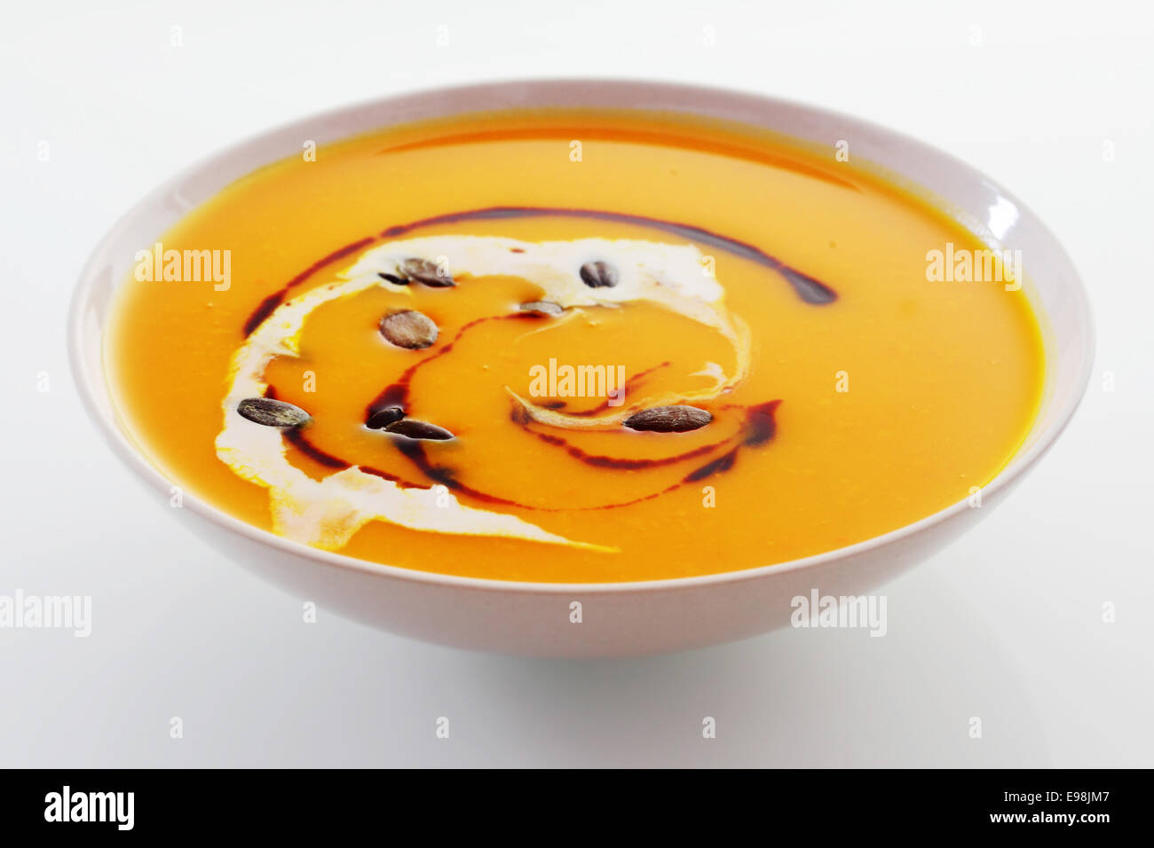 Creamy butternut or pumpkin soup for a tasty autumn appetizer for a Thanksgiving meal - Stock Image