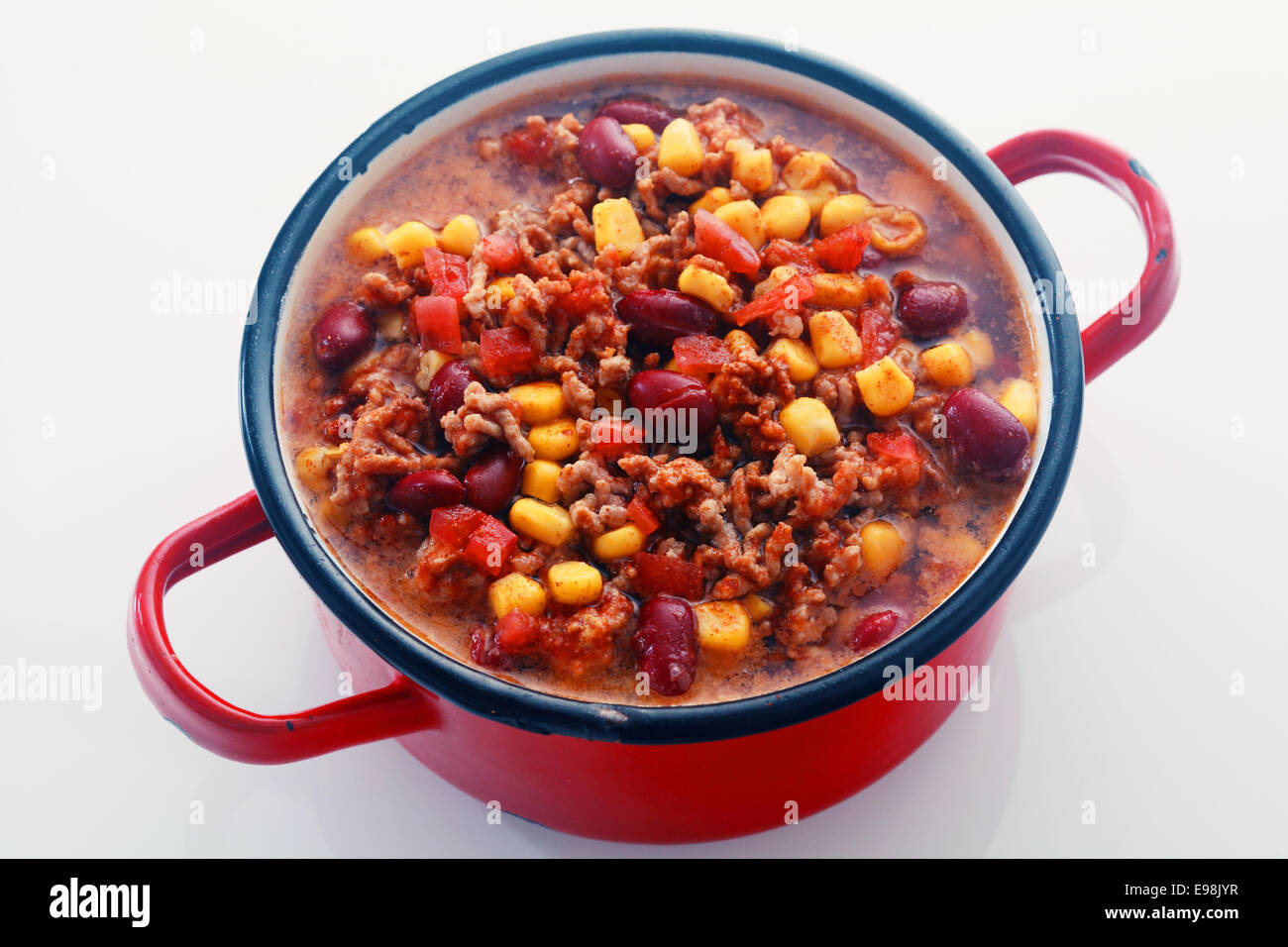 Close Tasty Main Dish Recipe on Red Pot Isolated on White Background. - Stock Image