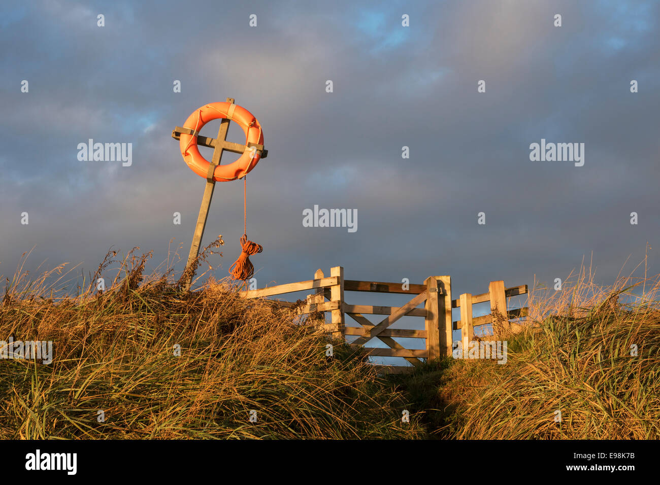 Beadnell Bay, Northumberland, Beach access with lifebelt  morning. - Stock Image