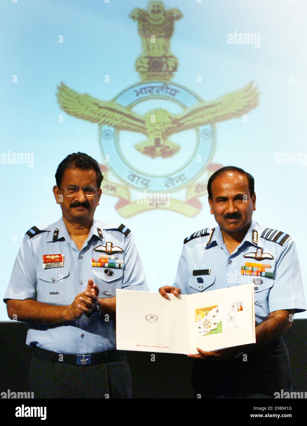 In the right: The Chief of the Air Force Staff, Air Chief Marshal Arup Raha releases the first day cover on the - Stock Image