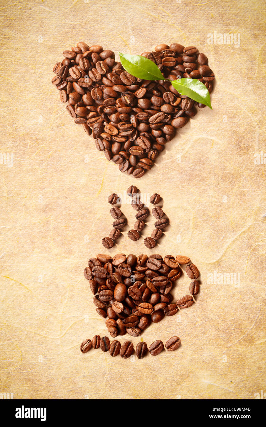 Hot Coffe Cup and a heart shape figured with coffee beans Stock Photo