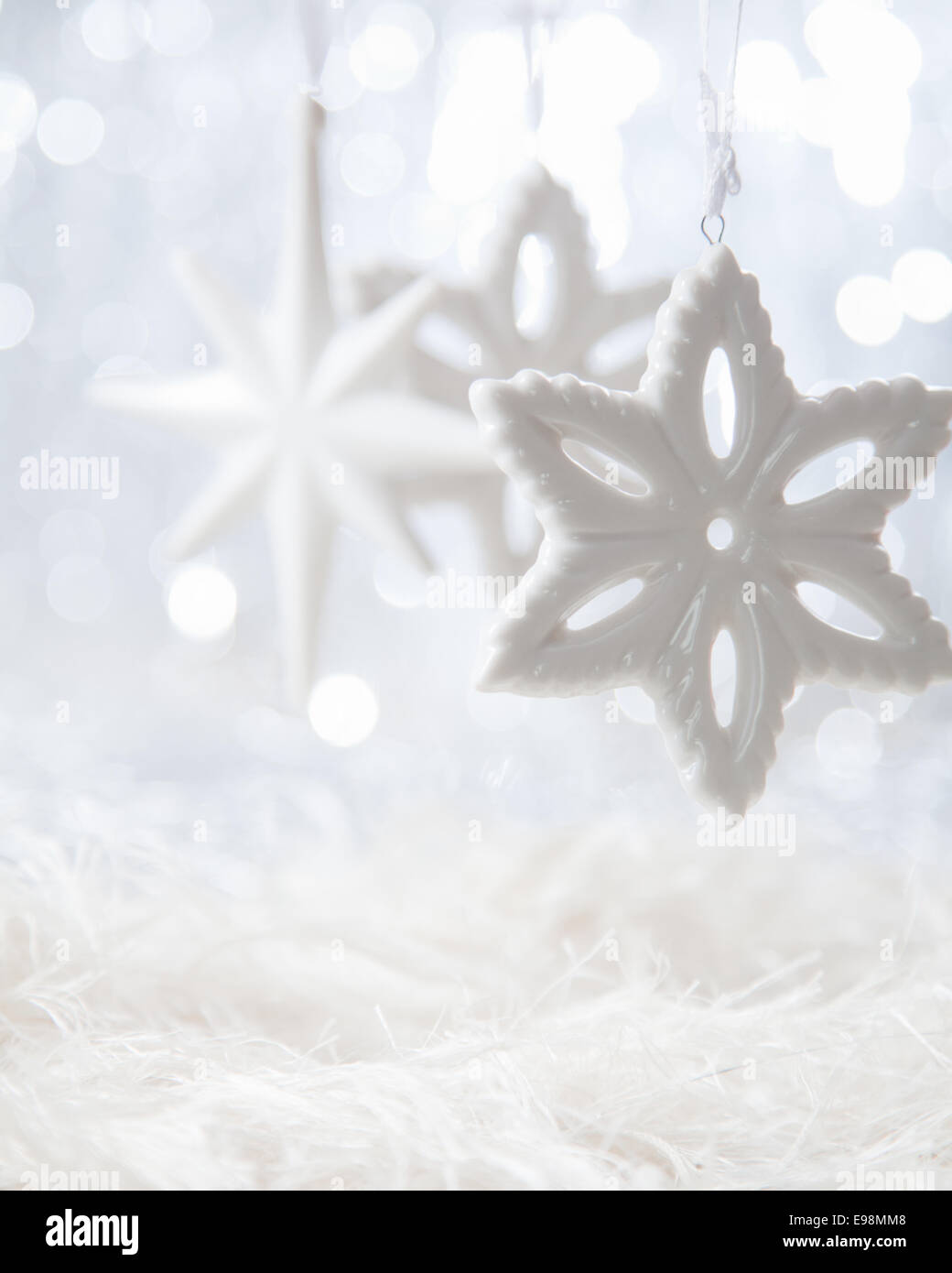 Bright Christmas stars on white boketh background - Stock Image