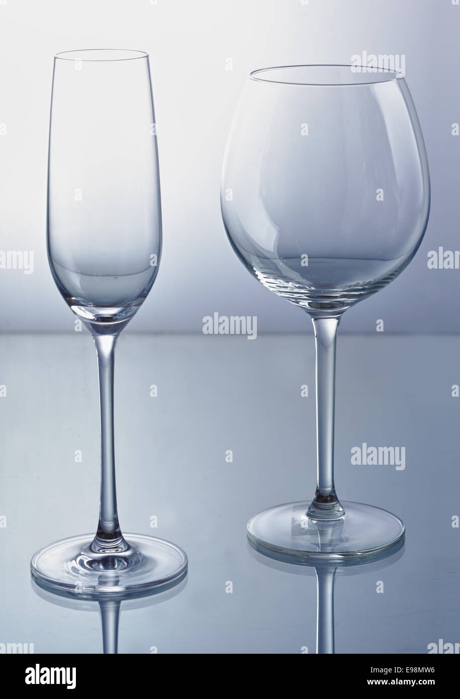 Empty wine and champagne glass with reflexion. - Stock Image