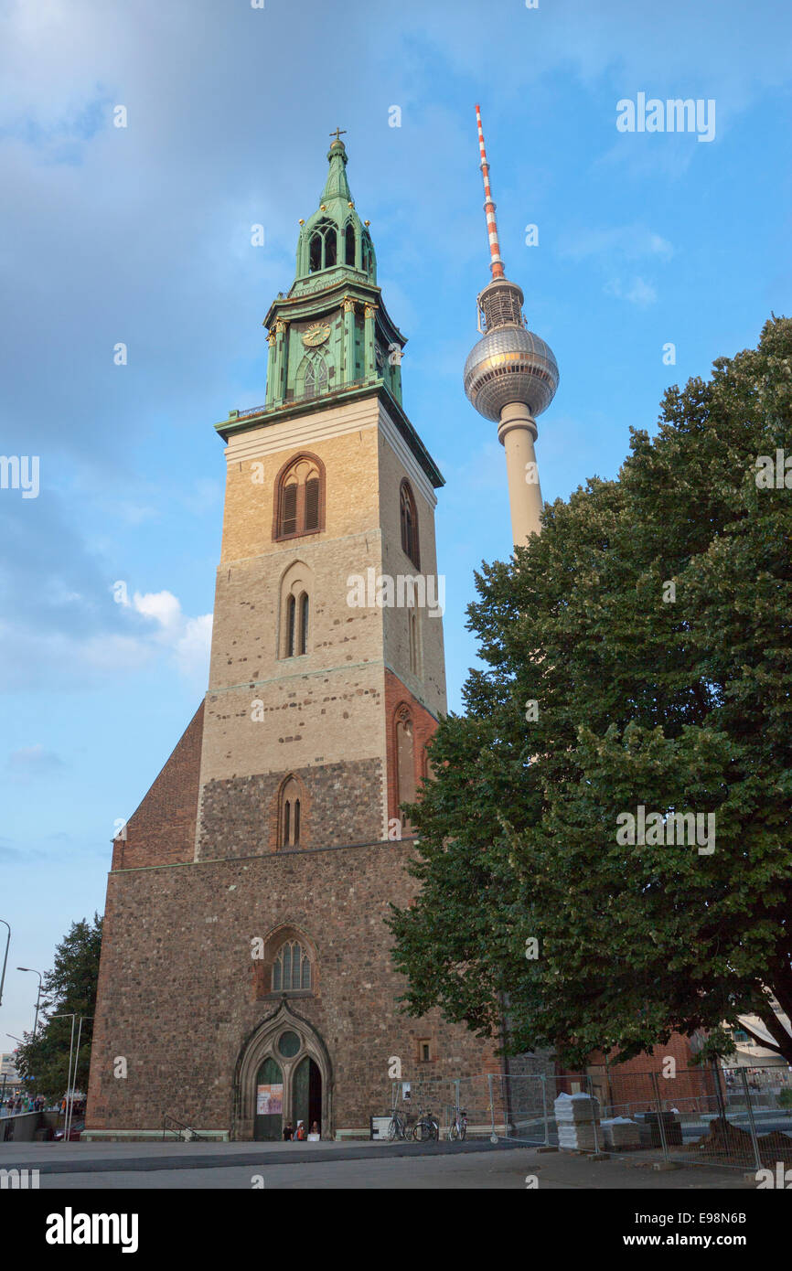St. Mary's Church known as Marienkirche with Fernsehturm television tower in background. Berlin, Berlin-Brandenburg. - Stock Image