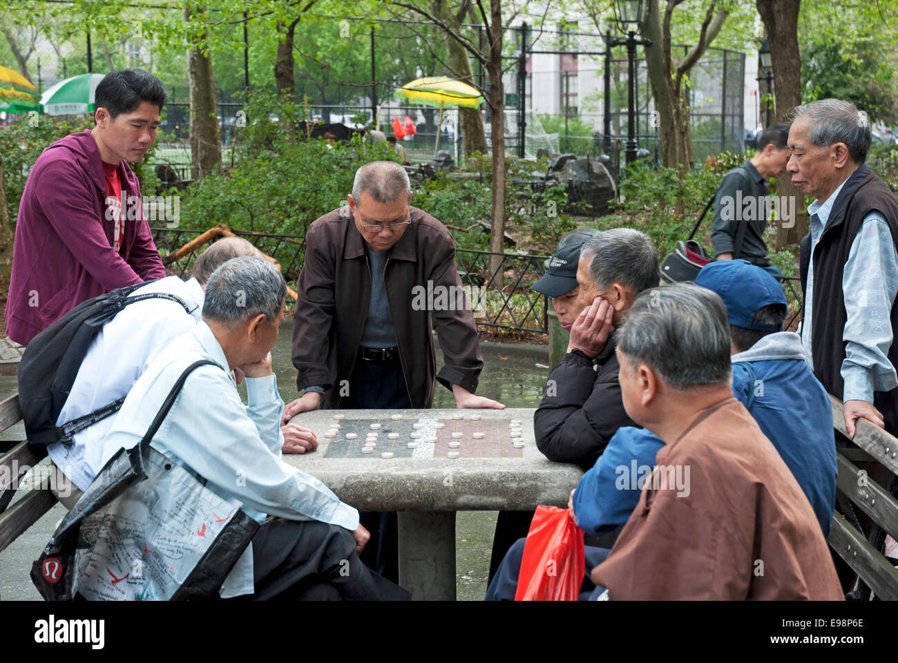 Elderly Men Playing Chinese board game go in Manhattan, New York - Stock Image