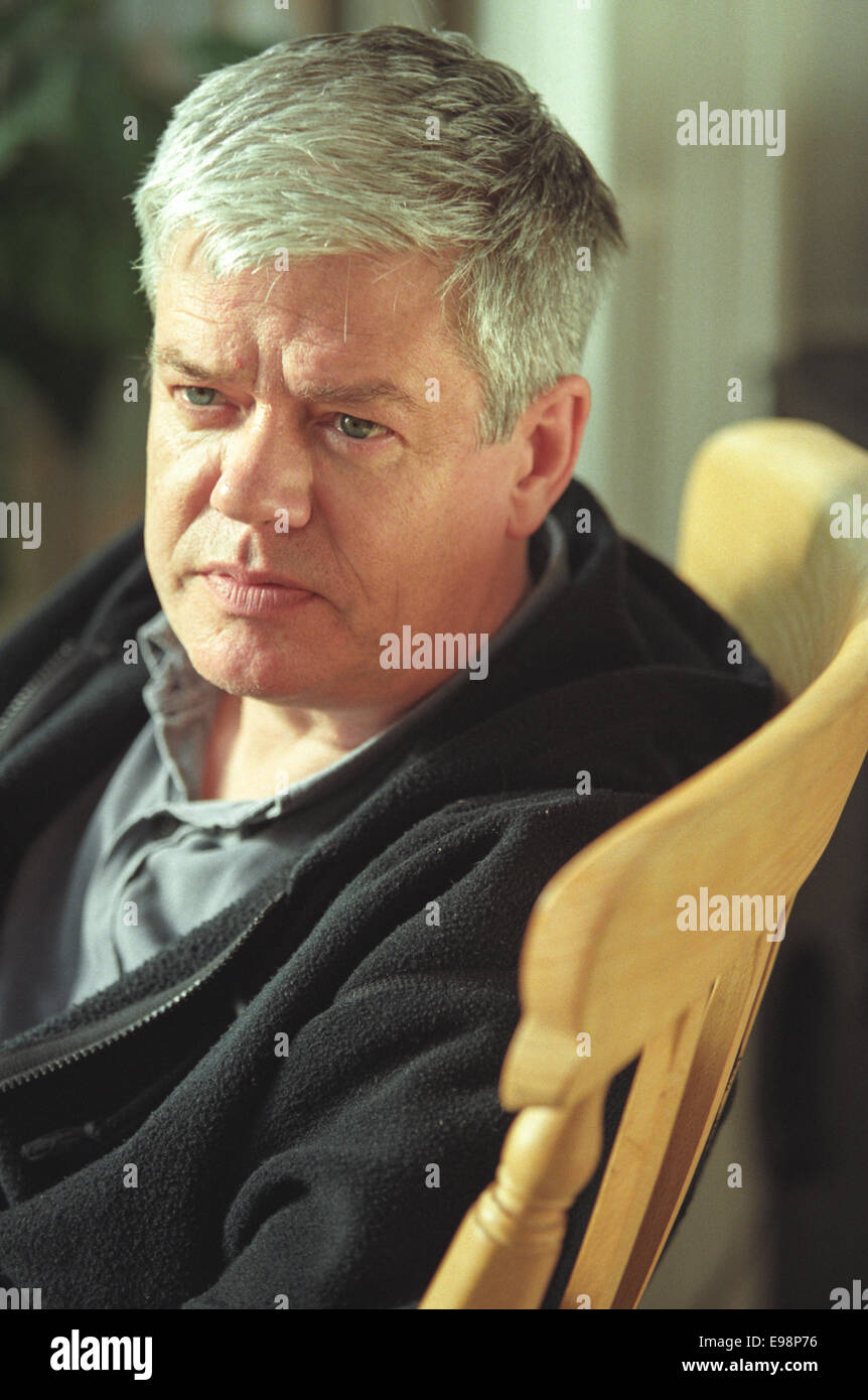 Author Bernard MacLaverty in his West End apartment, in Glasgow, Scotland - Stock Image