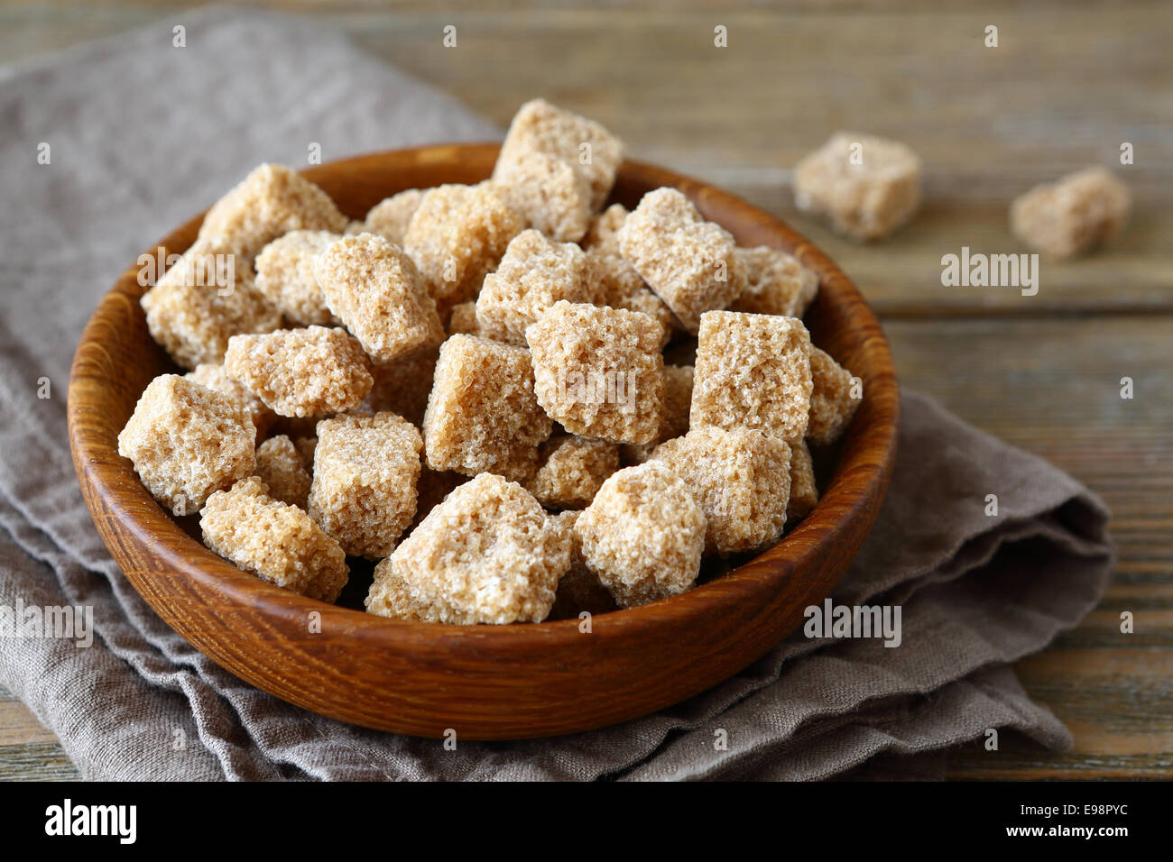 Sweet brown sugar in a bowl, close-up - Stock Image