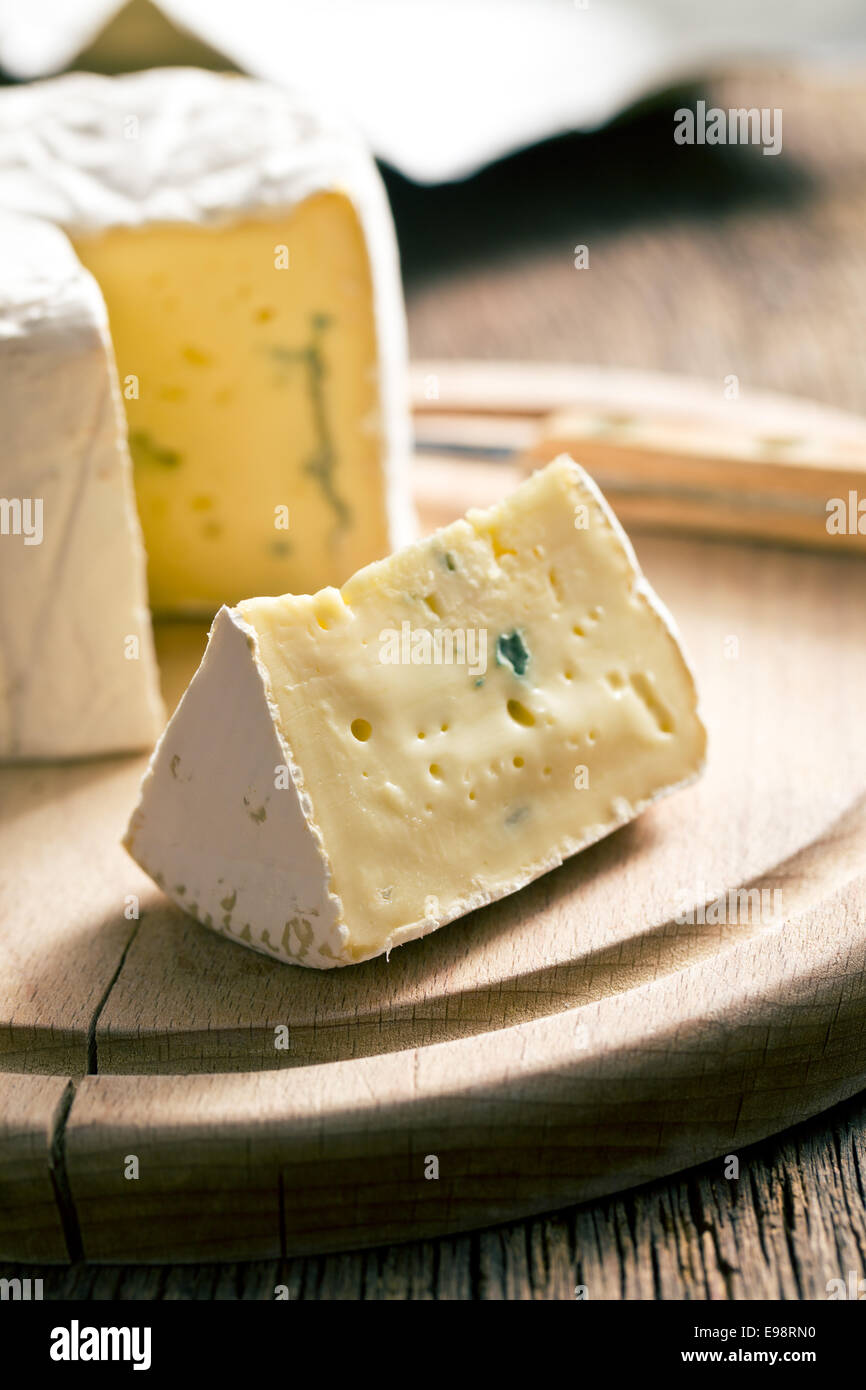 blue cheese on cutting board - Stock Image