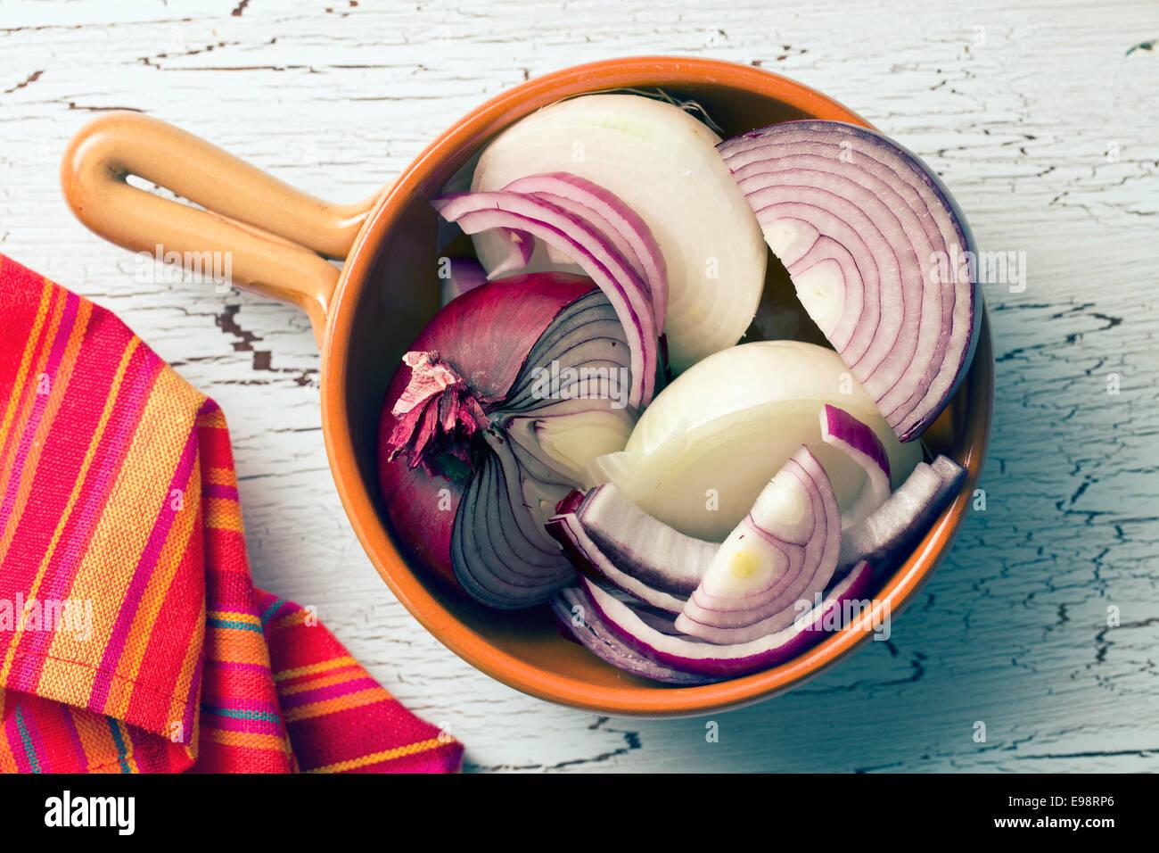 chopped onion in ceramic pan - Stock Image