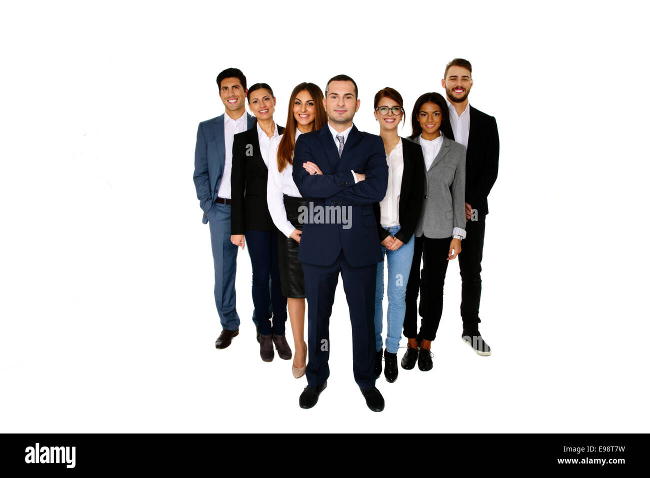 Smiling man leading his happy team over white background - Stock Image