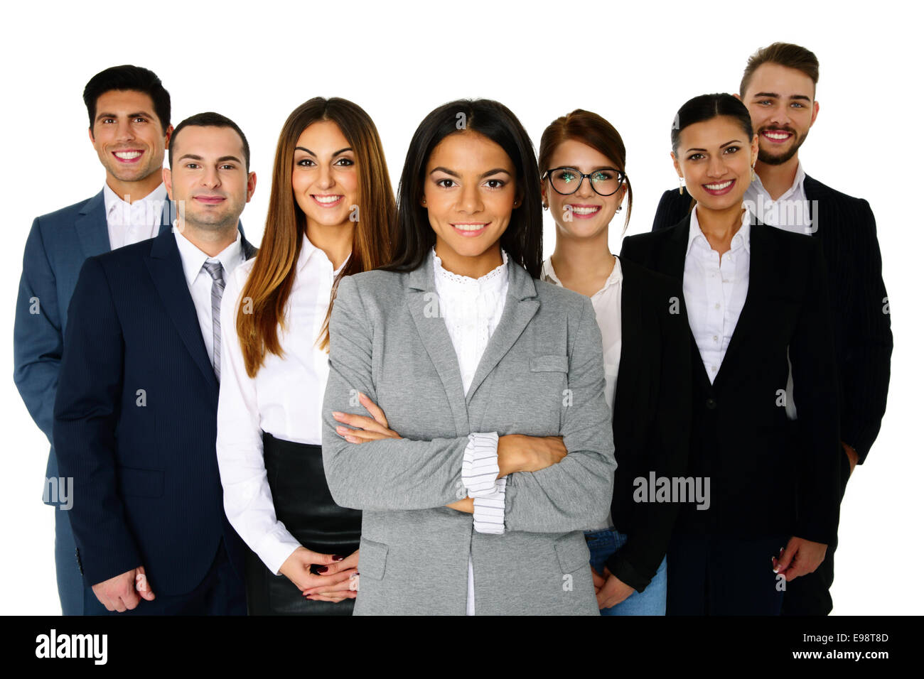 Smiling woman leading her happy team over white background - Stock Image