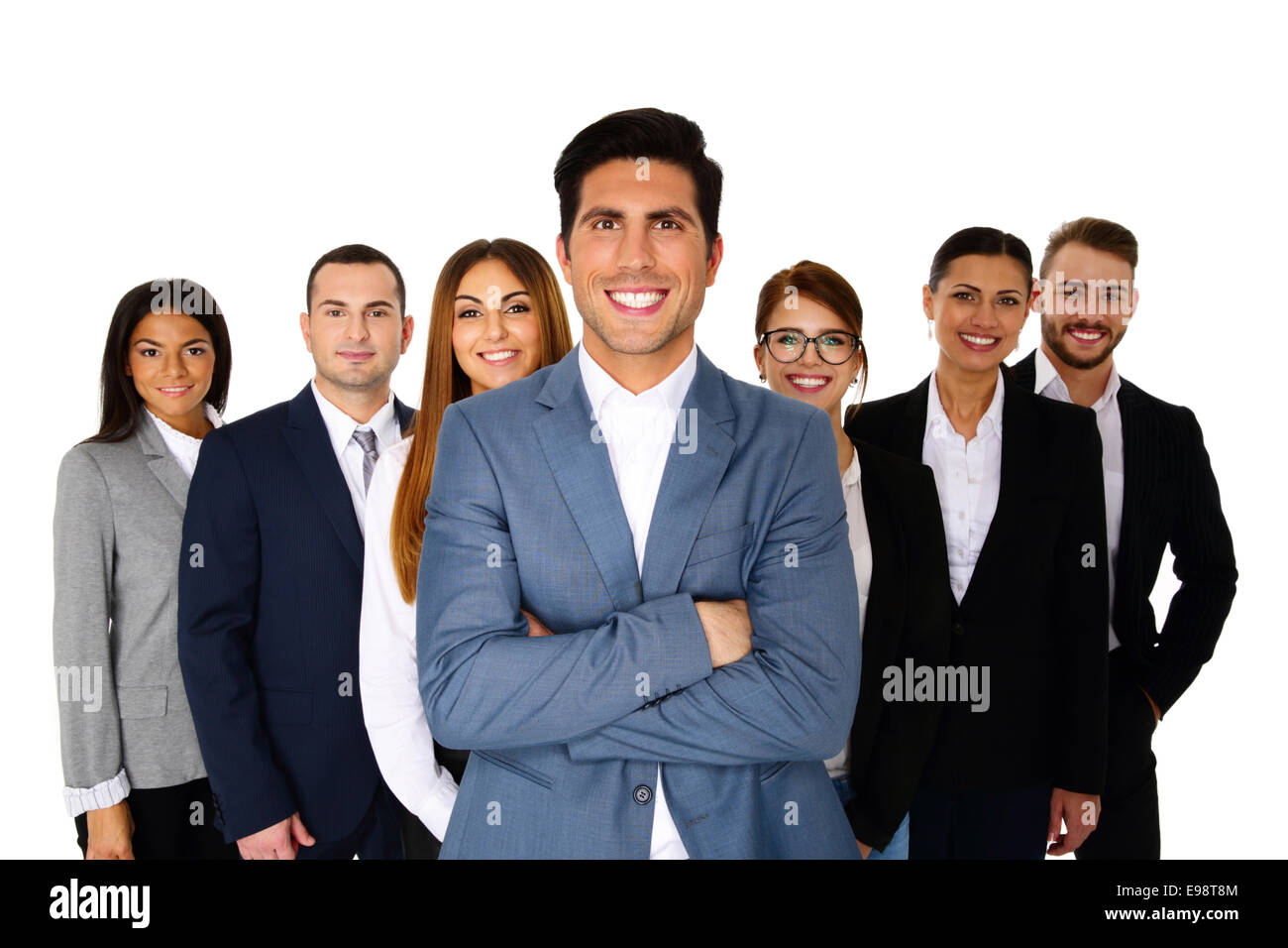 Cheerful man leading his happy team over white background - Stock Image
