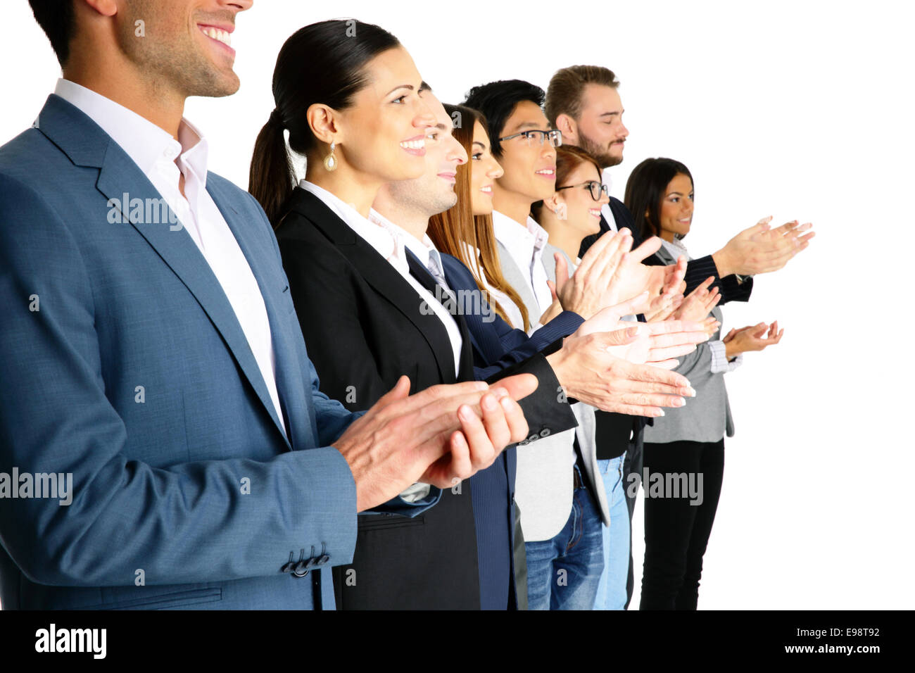 Group of businesspeople applauding - Stock Image