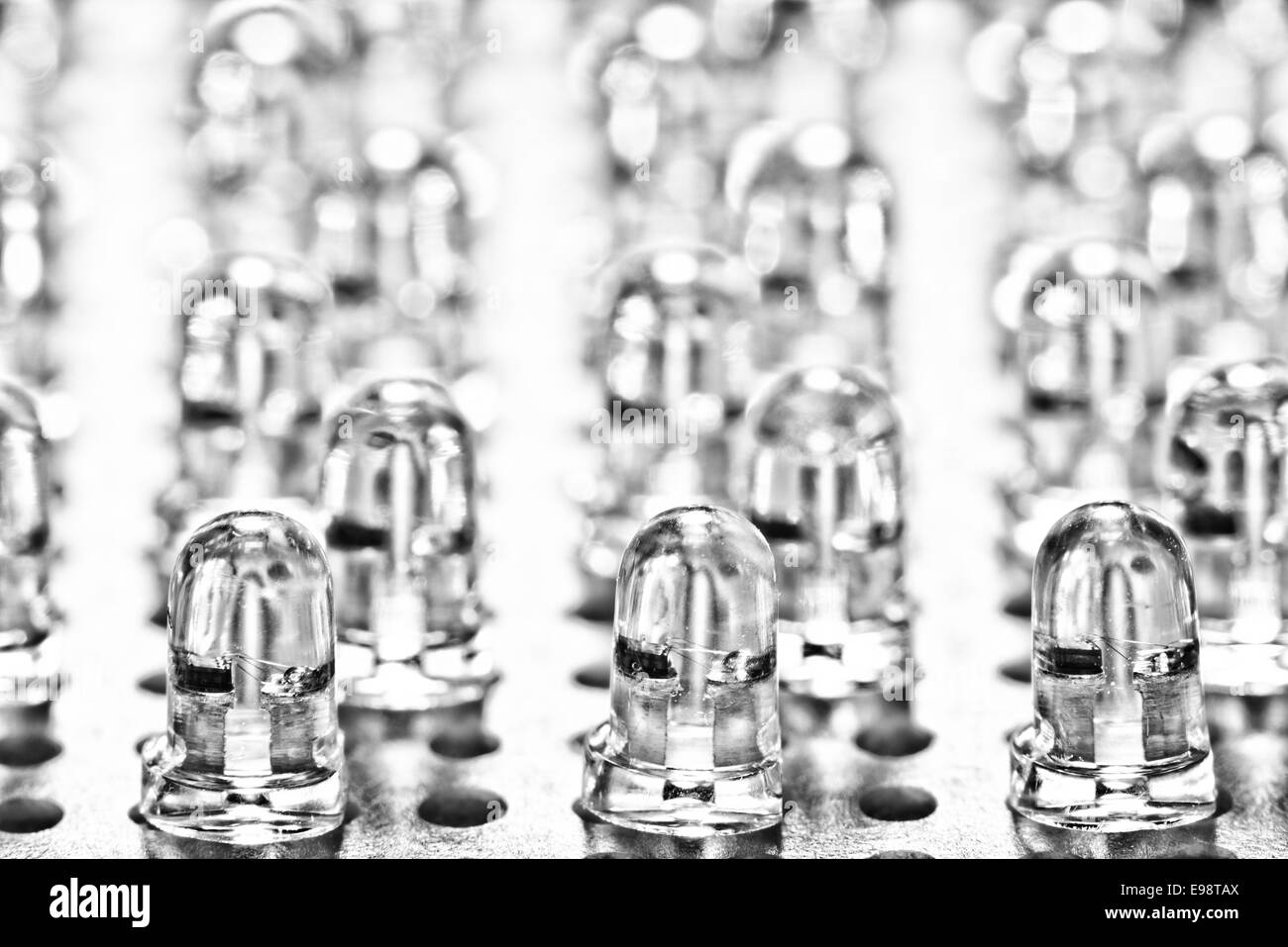 close up of row of light led light emitting diodes as part of a lighting circuit with anode and cathode - Stock Image
